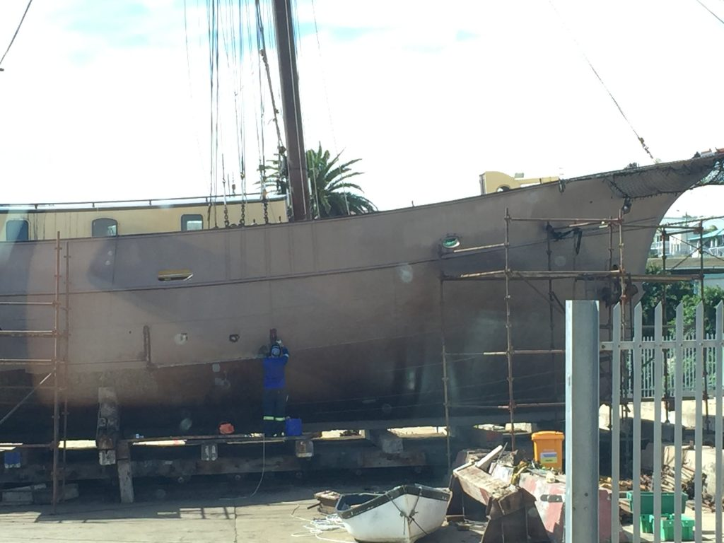 Painting a century old gaff-rig schooner in Mossel Bay